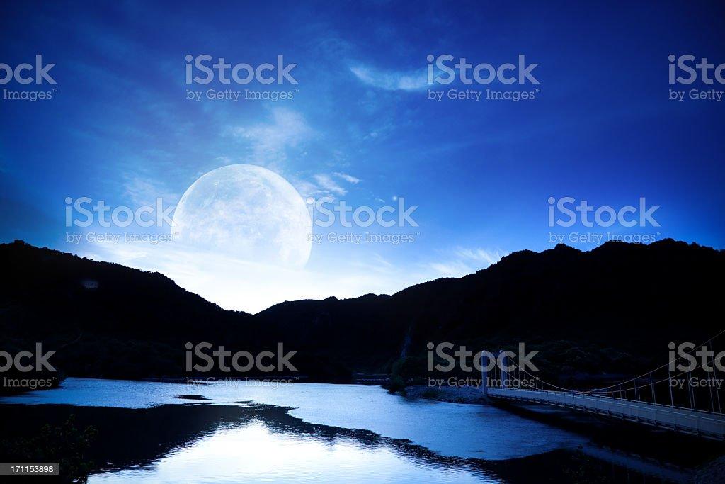 Moon over lake stock photo