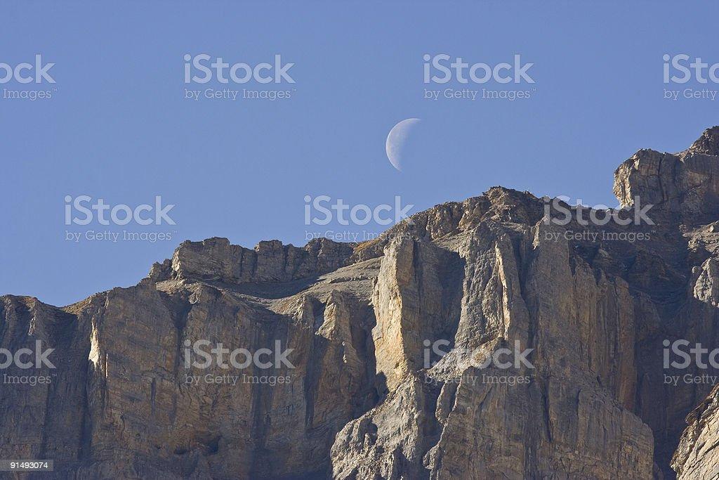 Moon over mountain peak stock photo