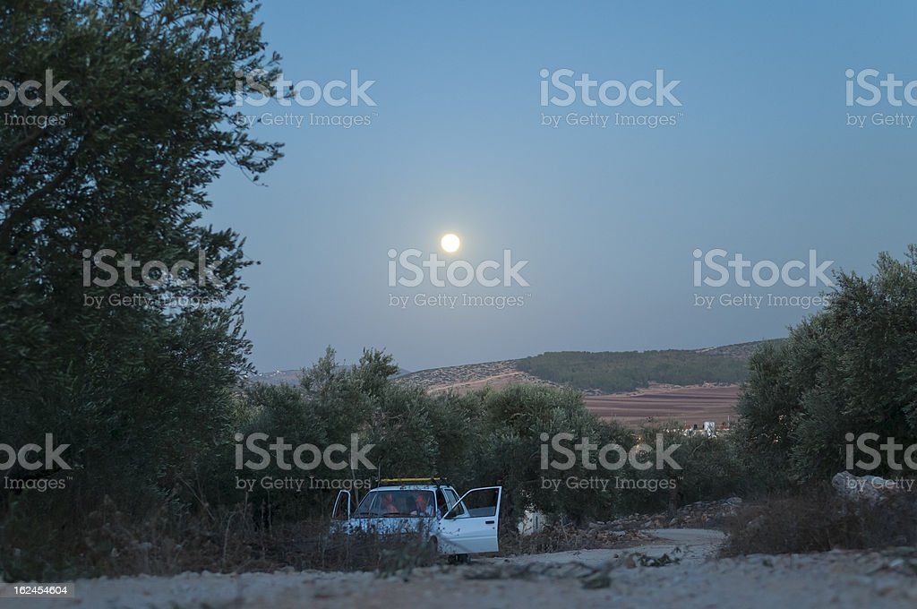 Moon over Palestinian village of Zababdeh, West Bank royalty-free stock photo