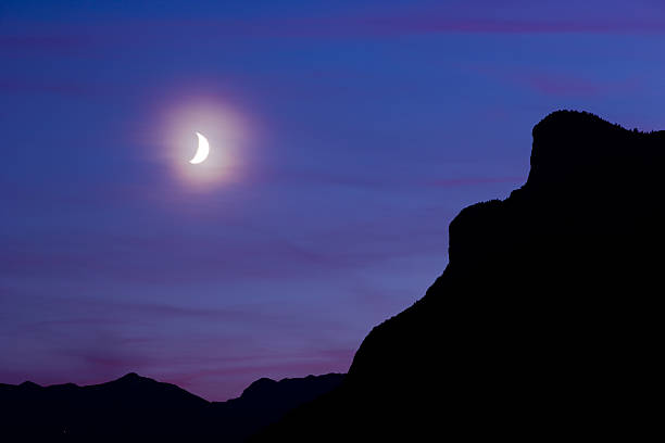 Moon over Silhouette Mountains stock photo