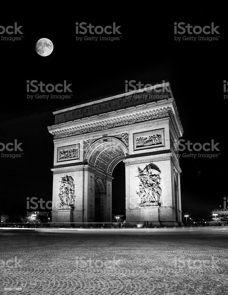 Moon Over The Arc De Triomphe stock photo