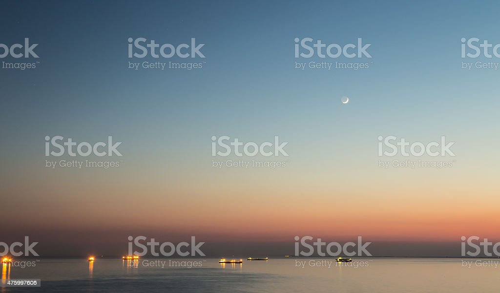 moon over the boats stock photo