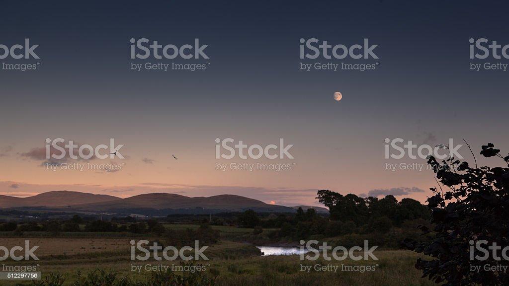 Moon over the Machars stock photo