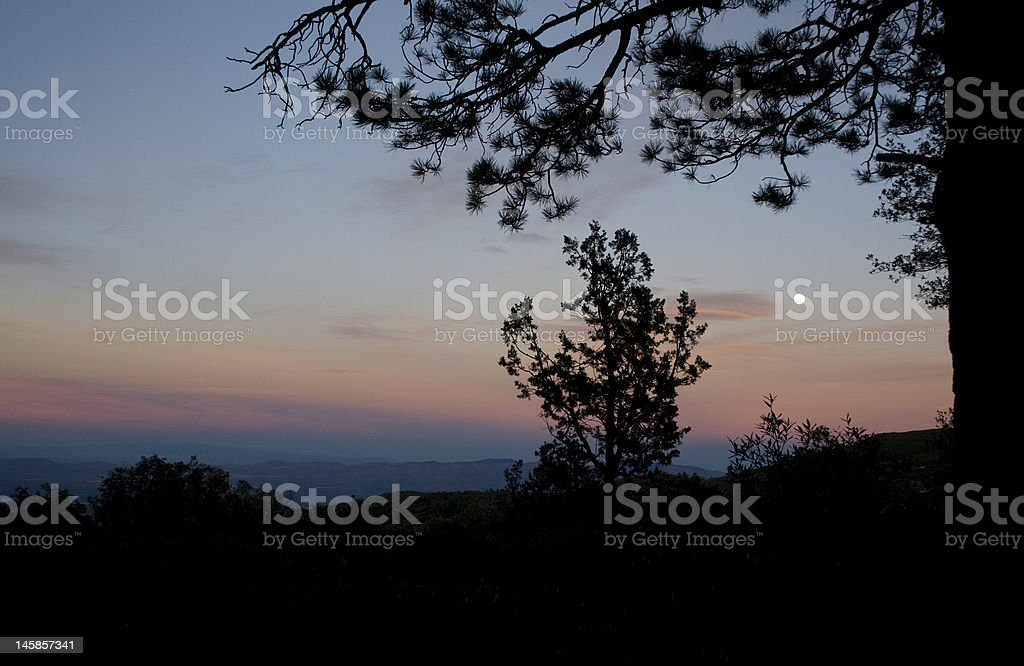 moon over the mountains stock photo