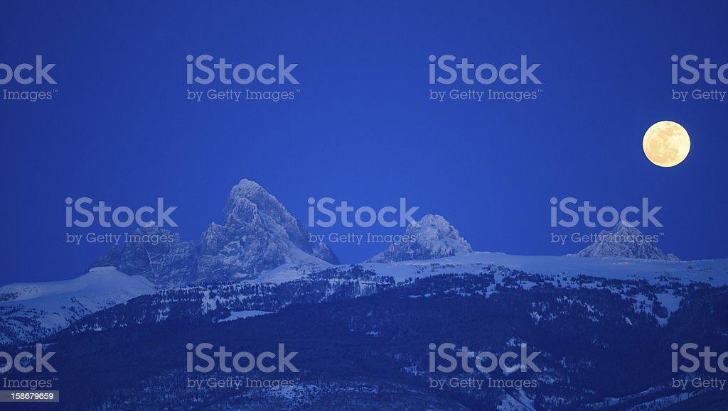 Moon Over The Teton's stock photo
