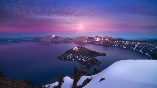 Moon rise after sunset at Crater Lake stock photo