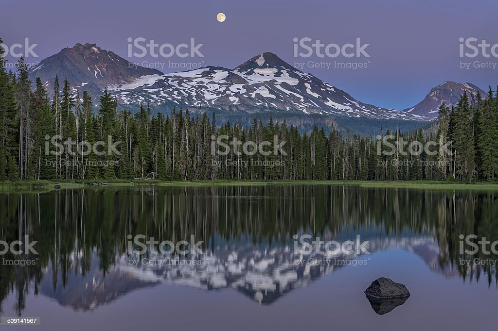 Moon Rise at Sunset stock photo