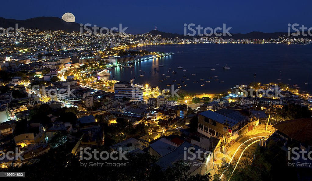 Moon rise over Acapulco Mexico Aerial view of Acapulco Mexico with the moon rising Acapulco Stock Photo