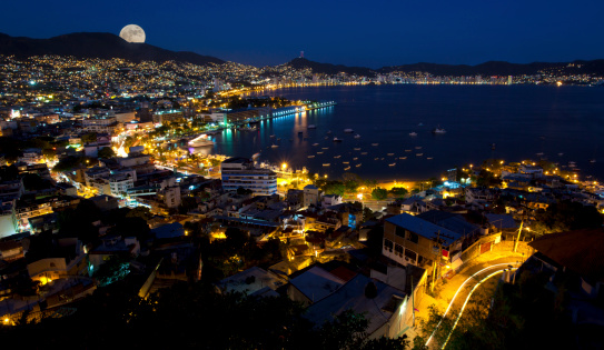 Moon Rise Over Acapulco Mexico Stock Photo - Download Image Now