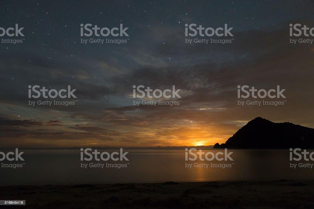 Moon rising in Abel Tasman National Park stock photo