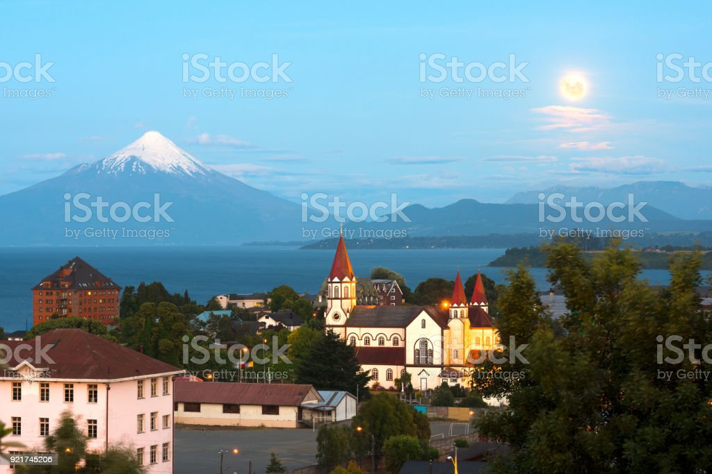 Moon rising on Puerto Varas at the shores of Lake Llanquihue in Chile stock photo
