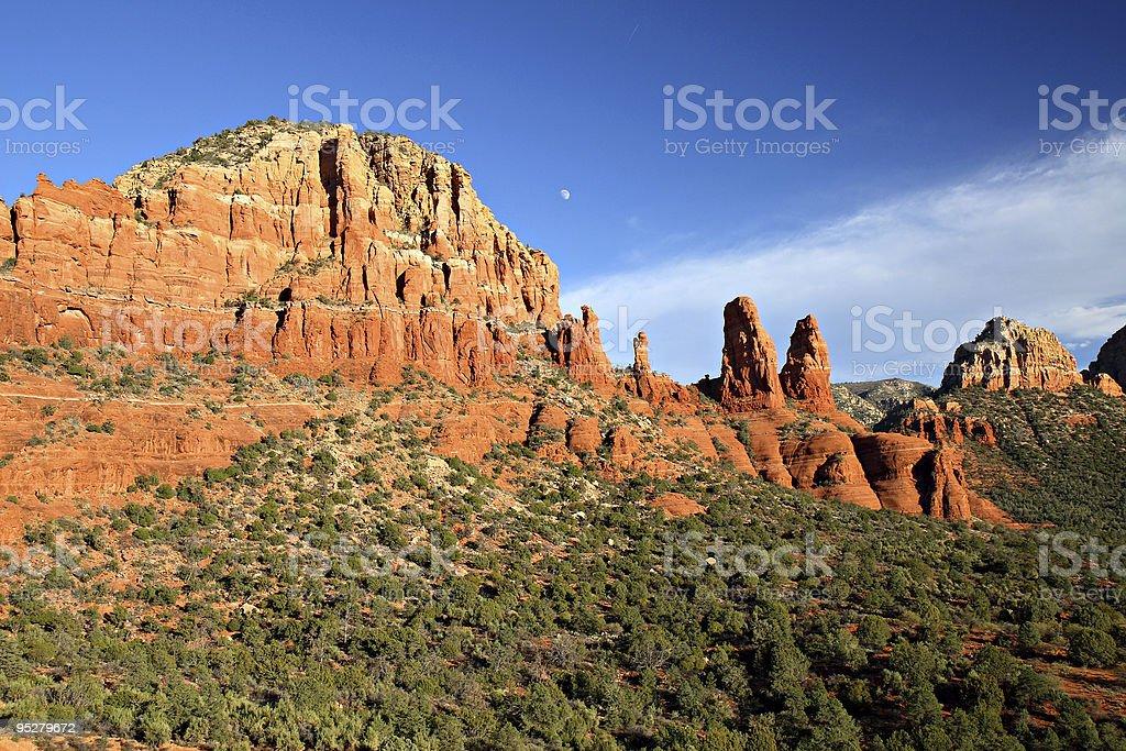 Moon Rising Over Red Sandstone Bluffs in Sedona, Arizona stock photo