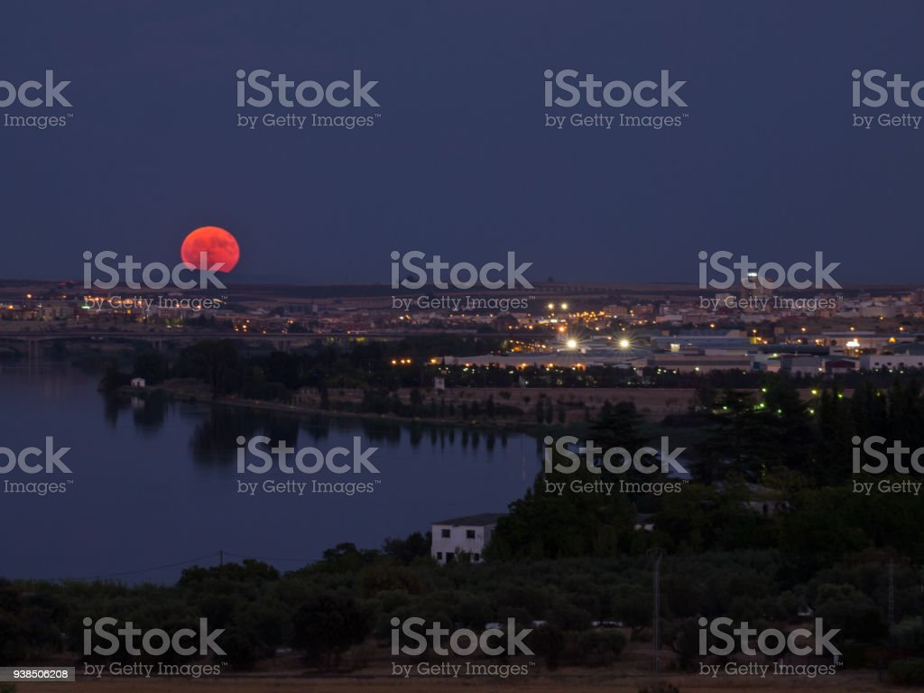 moon rising over the city of Mérida and the Guadiana river, Extremadura, Spain stock photo