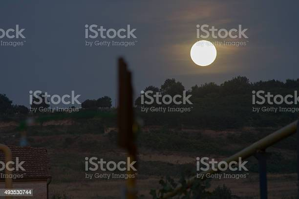 Photo of moon rising over the hill