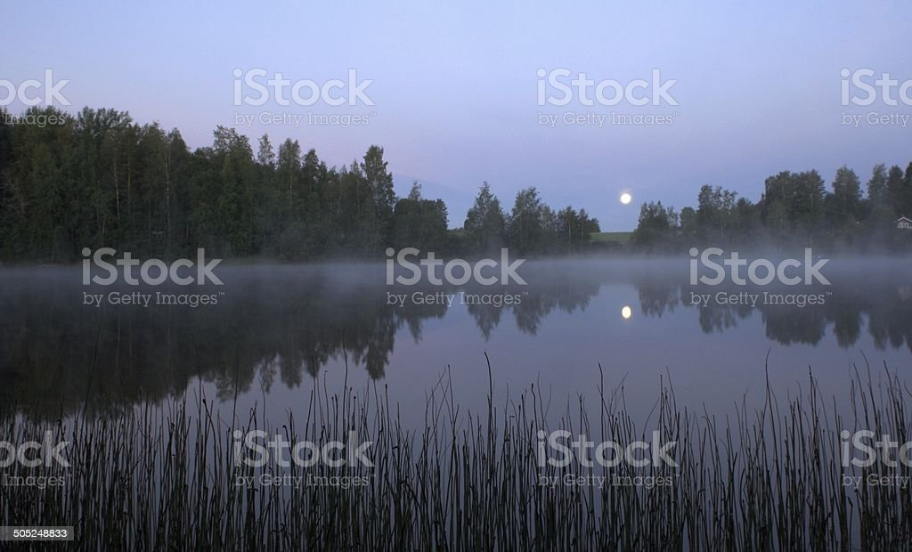 Moon set before dawn stock photo