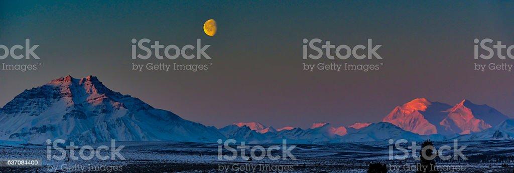 Moon Set Over Denali and Alaska Range, Alaska stock photo