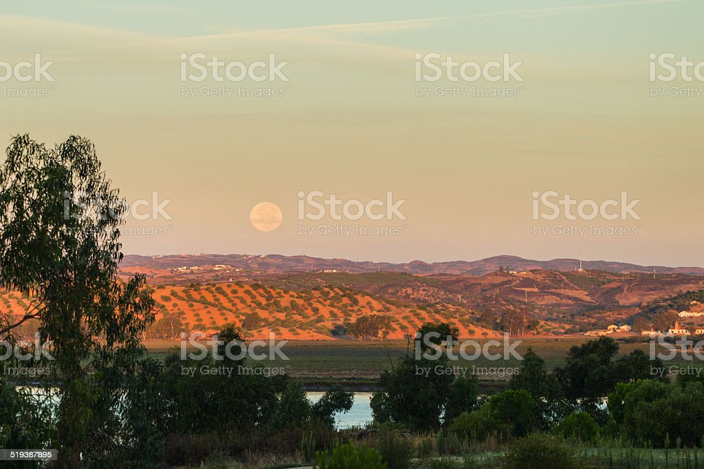Moon setting over Portugal as seen from Spain stock photo