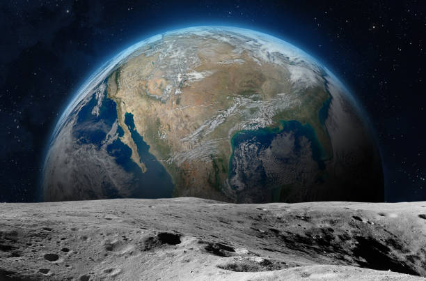 Moon surface and planet Earth. View on the planet Earth from the Moon surface. Elements of this image are furnished by NASA moon stock pictures, royalty-free photos & images
