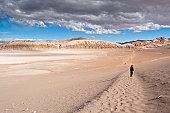 Man walking in Moon Valley (Atacama, Chile)
