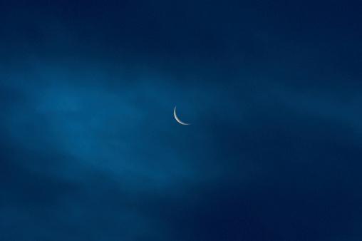 moon, waning crescent, seen through a thin cloudlayer