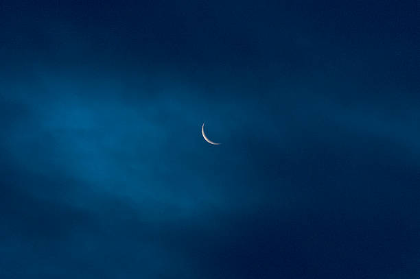 moon, waning crescent, seen through a thin cloudlayer stock photo