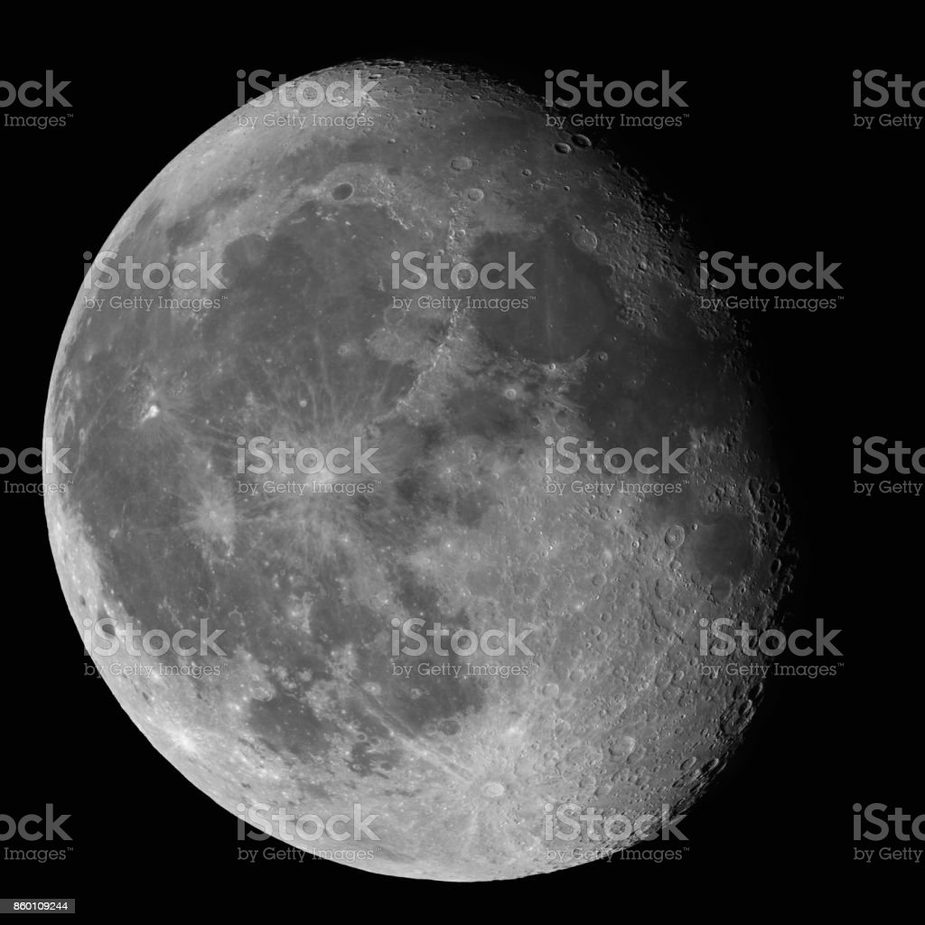 Moon Waning Gibbous 87% phase against black night sky high resolution image stock photo