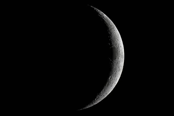 moon waxing crescent. young moon. - moon stock pictures, royalty-free photos & images