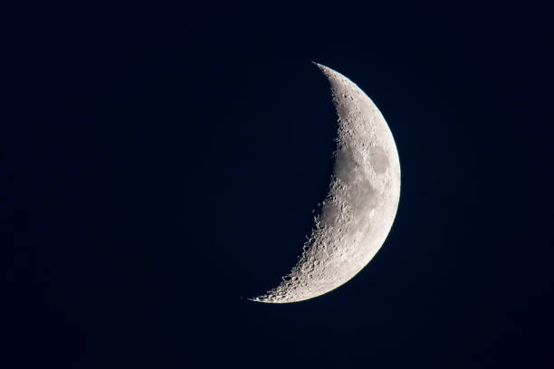 Moon with a clearly visible moon surface in the dark night sky. stock photo