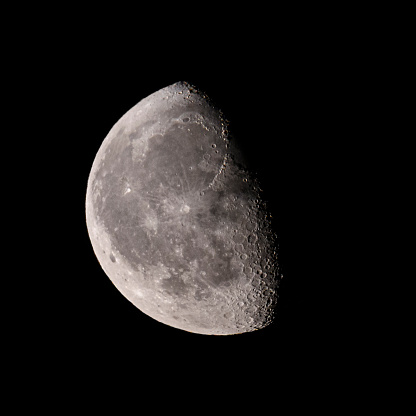 Moon with a clearly visible moon surface in the dark night sky