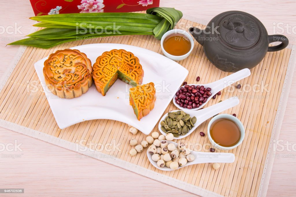Mooncake for Chinese mid-autumn festival celebration, wih ingredients and tea. stock photo