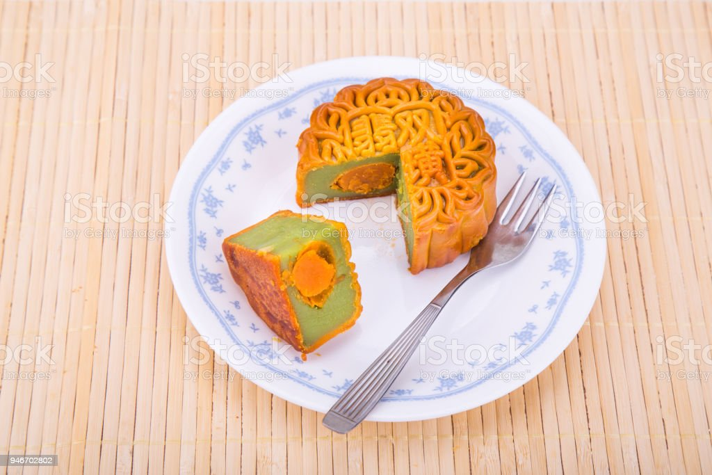 Mooncake with egg yoke for Chinese mid-autumn festive served stock photo