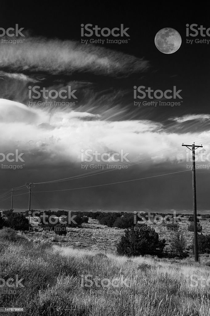 Mooning over clouds. Vertical. royalty-free stock photo