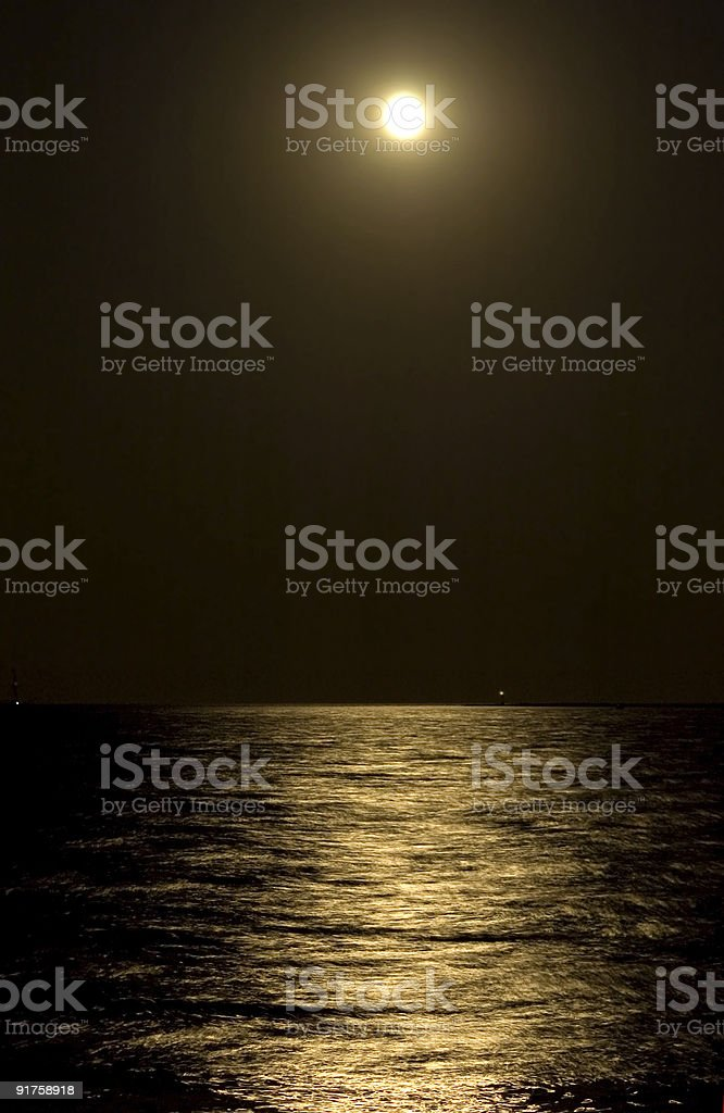 Moonlight Creating Path on the Water stock photo