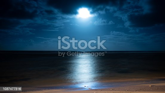 Moonrise on the eastern coast of Mauritius at Poste Lafayette.