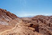 Panorama of Moon Valley (Valle de la Luna) in Atacama desert, snowy Andes mountain range in the background, Los Flamencos National Reserve in northern Chile's Atacama Desert