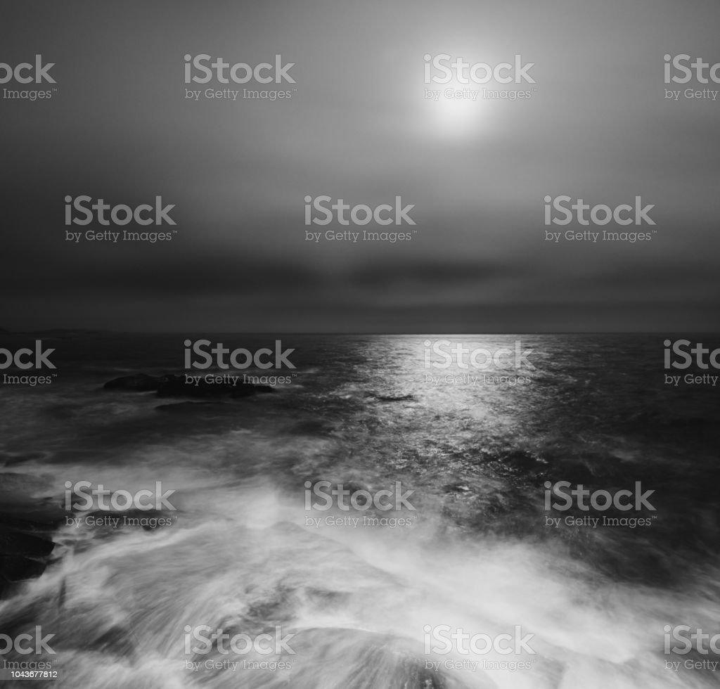 The light of the Full Moon on the Atlantic coast. Long exposure.
