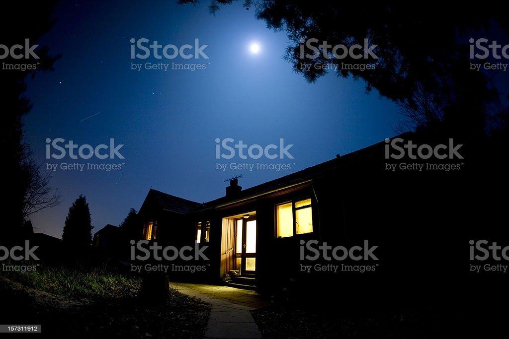 Moonlit house stock photo