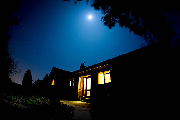Moonlit house stock photo