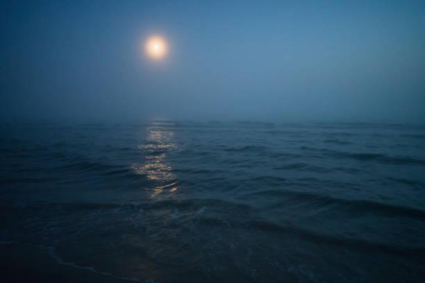 Moonlit shorewater of the Liepaja beach at night stock photo