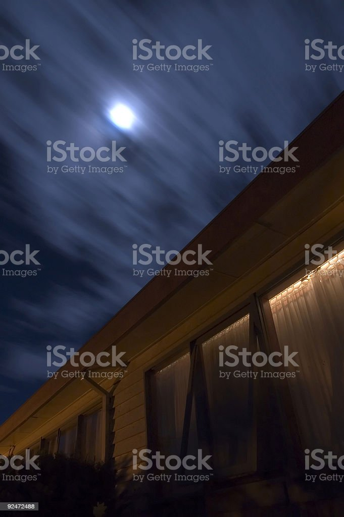 Moonlit sky with clouds streaking past royalty-free stock photo