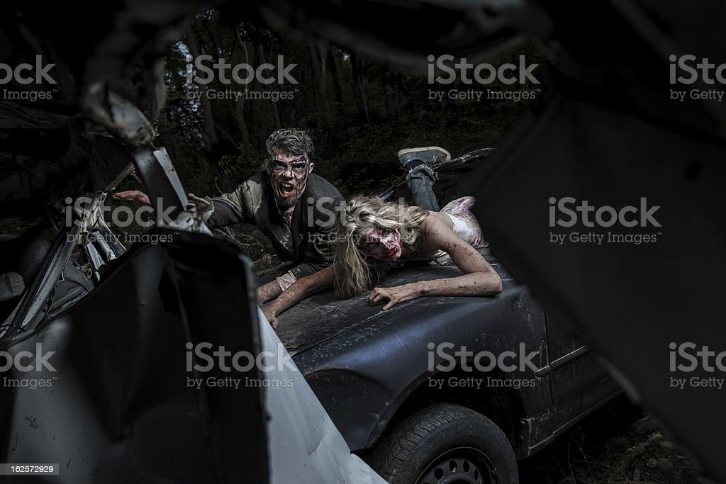 Moonlit Zombies In Car Crash Carnage stock photo