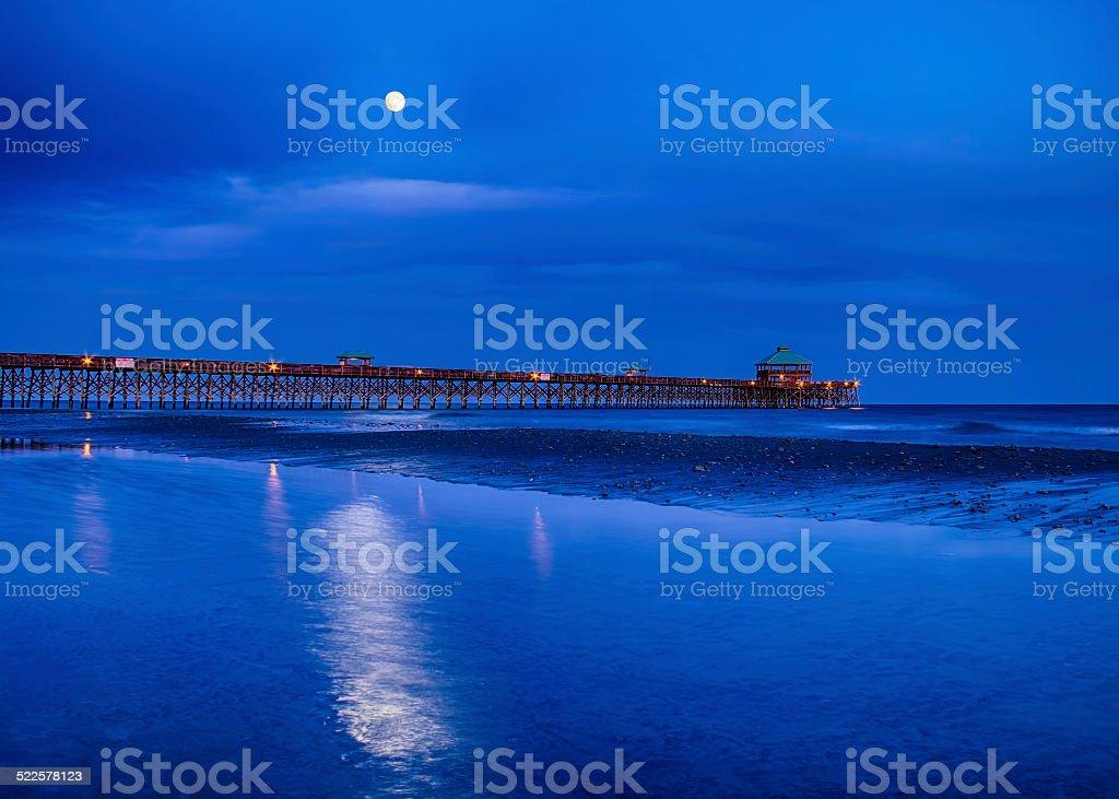 Moonrise at Folly Pier stock photo