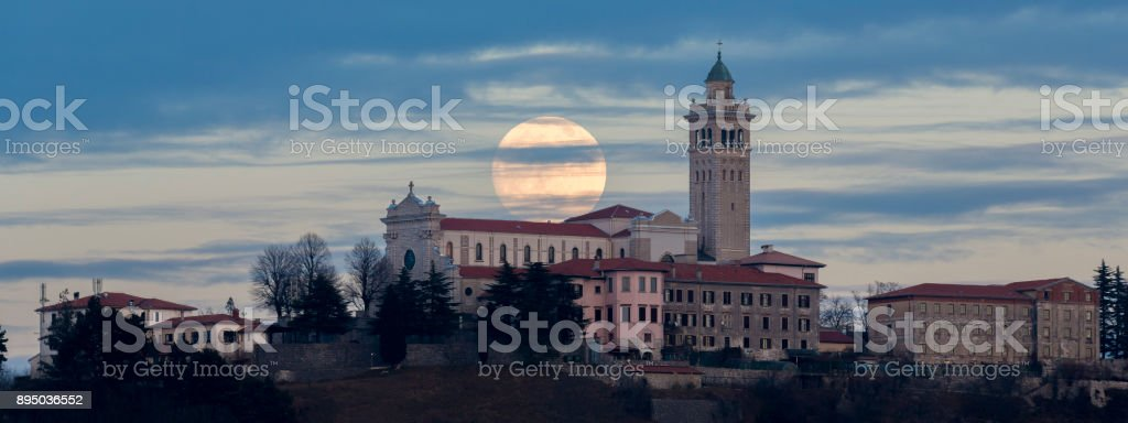 Moonrise Behind Church stock photo