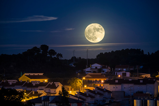 Moonrise in the city.