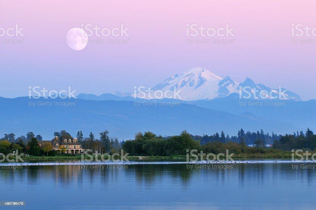 Moonrise over Mt. Baker at Wiser Lake stock photo