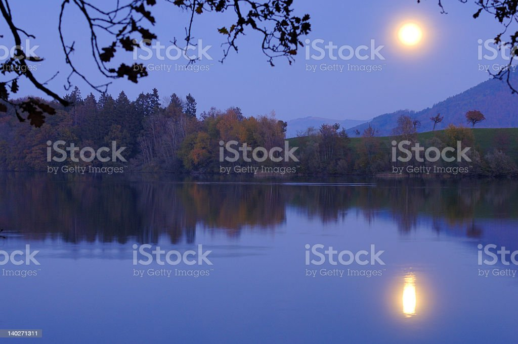 Moonrise over the lake royalty-free stock photo