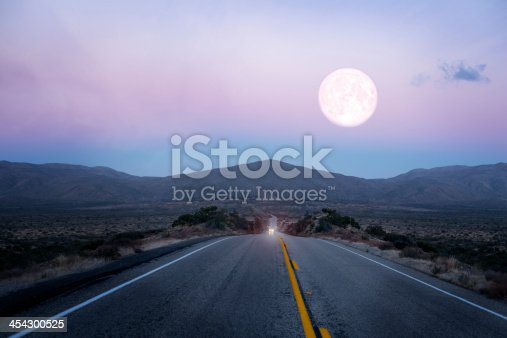 Moonrise over the lonely desert road