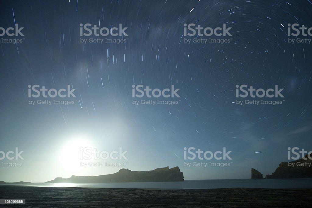 Moonrise under starry sky royalty-free stock photo
