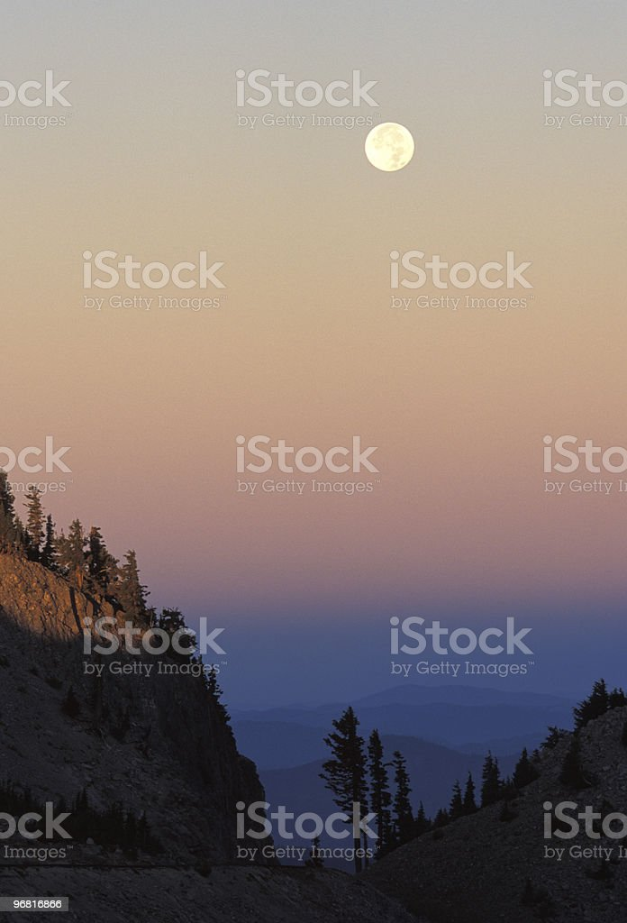 Moonset and Sunrise on Colorful Sky stock photo