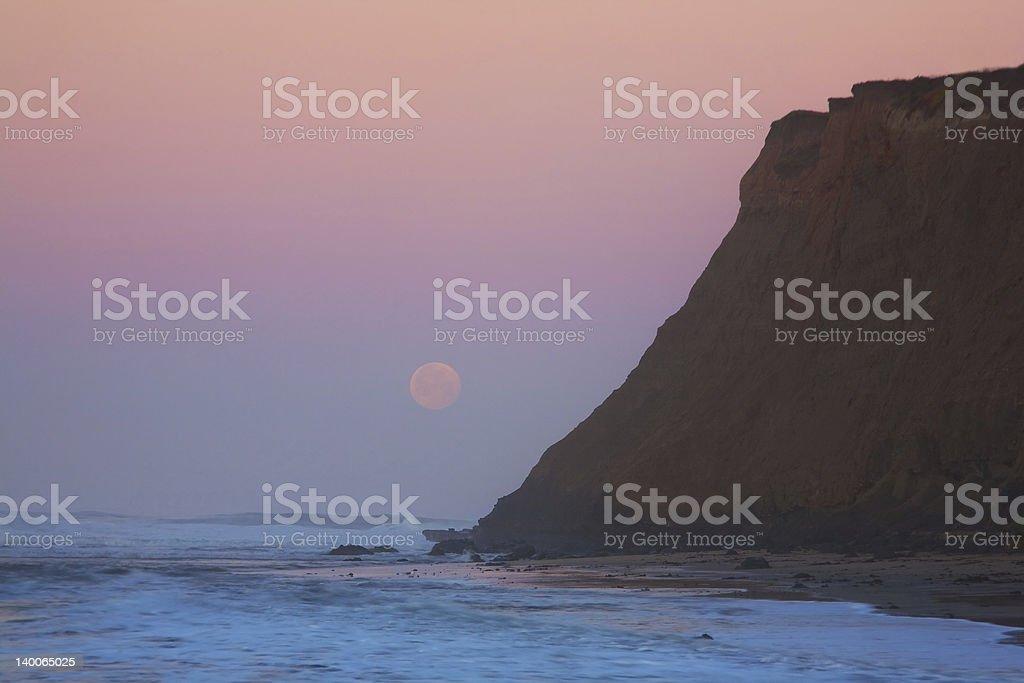 Moonset at Sunrise stock photo